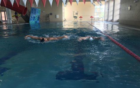 Brielle Thomas and Shaye Davison swim at the Fruita REC after school.